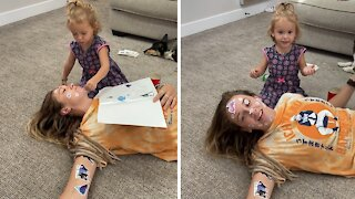 Woman hilariously demonstrates how to survive a sticker attack