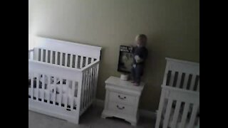Check out this baby ninja's moves as he climbs into his twin's crib