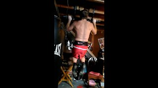 8 Pullups with 45 pounds attached