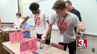 Shrine Bowl athletes interact with Shriners Hospital patients