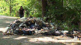 A mountain of trash blocking roadway