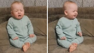 Cute baby has adorable sneezing attack