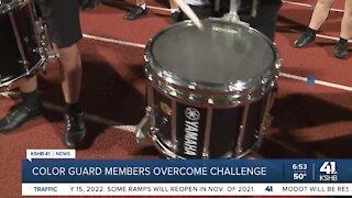 Color guard members overcome challenge