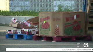 Police search for suspect who opened fire on church food drive, injuring 2 people