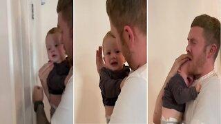 Baby cries when dad pretends to bang head on door