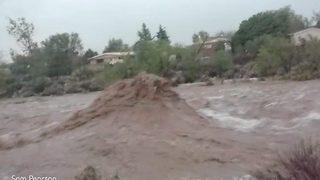 Massive flooding creates bizarre water mountains next to road