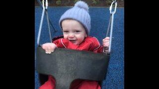 Cute baby slow motion swing