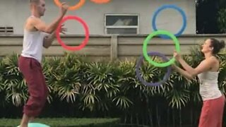 Juggling couple perform amazing tricks