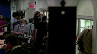 President abruptly escorted from press briefing