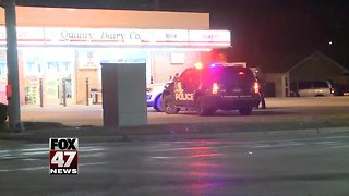 Police investigating two armed robberies in Lansing