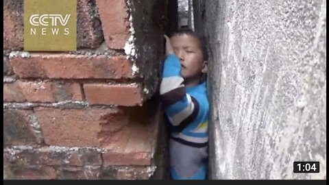 Naughty boy get stuck in narrow wall