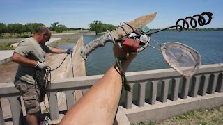 MAGNET FISHING A HUGE DAM I CAN'T BELIEVE WE FOUND THIS!!