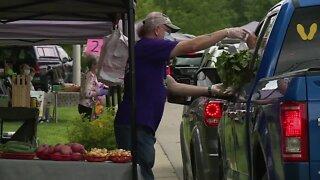 Customers visit drive-thru farmers' market