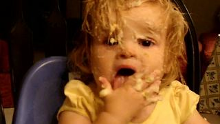 """""""Little Girl Rubs Mashed Potato Into Face and Hair"""""""
