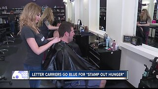 Letter carriers go blue to Stamp Out Hunger