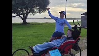 Bond between runner, wheelchair-bound student stretches beyond track