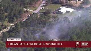 Crews battle 5-acre brush fire in Spring Hill