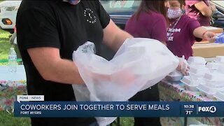 Coworkers join together to serve meals
