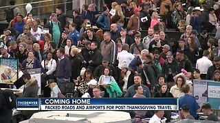 Travelers navigate holiday crowds at Denver International Airport