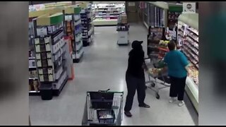 Woman steals wallet at grocery store