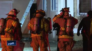 Crews fight an overnight house fire in De Pere