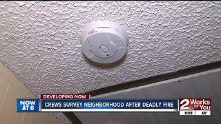 Crews survey neighborhood after deadly fire