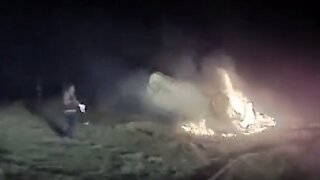 California police officer rescues woman stuck in flaming car