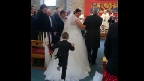 Kid Dives Onto Back Of Bride's Wedding Dress During Ceremony