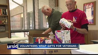 Volunteers wrap gifts for veterans ahead of holidays