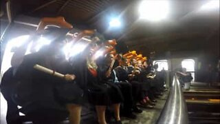 Students celebrate their graduation on a roller coaster