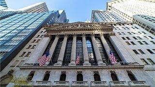 Wall Street Slides, Trump Warns China Tariffs