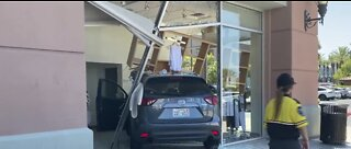 Woman drives into building