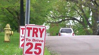 Neighbors create signs to slow down speeding drivers