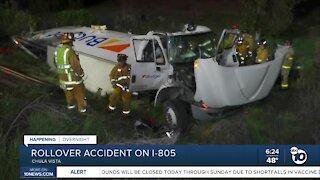 Box truck rolls over, crashes off I-805