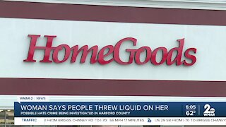 Woman says people threw liquid on her