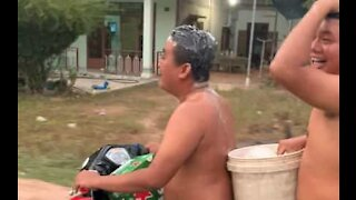 Guys wash their hair while riding motorbike