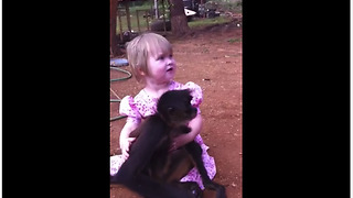 Pet monkey adorably cuddles with little girl