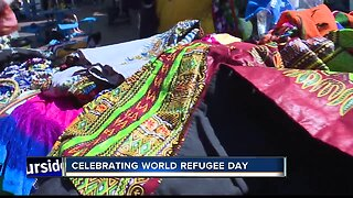 Community members gather for world refugee day at Grove Plaza