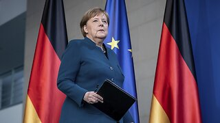 German Chancellor Angela Merkel Returns To Work After Self-Quarantine