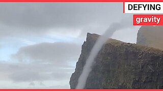 Incredible moment water flows UPWARDS in a rare sea vortex