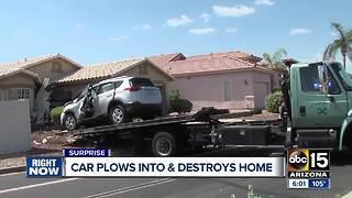 Car crashes into Surprise home, driver hurt