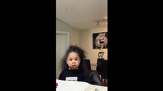 Patient little girl adorably passes the fruit snack challenge