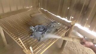 Sandblasting a motor case