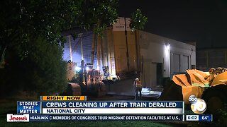 Crews work to clean up mess after train derailment