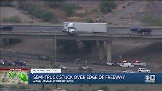 Semi-truck loses control, gets stuck on edge of freeway ramp