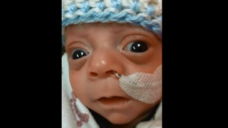 Newborn baby smiles for the very first time