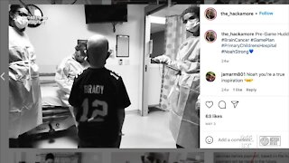 Boy who beat brain cancer meets his hero, Tom Brady