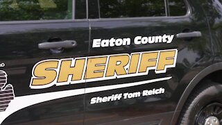 A man accused of killing his parents and brother was arraigned Monday in Eaton County Circuit Court.