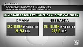 What economic impact do immigrants bring to Omaha and Nebraska?