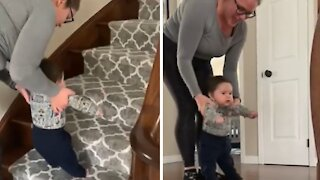 Mommy helps excited baby go up the staircase